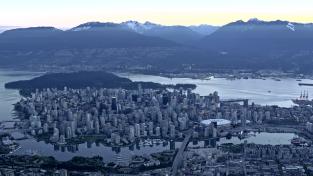 AERIAL Vancouver at dusk Aerial shot of the city of Vancouver at dusk. Shot in Canada. vancouver canada stock videos & royalty-free footage