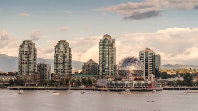 Vancouver Real Estate Architecture at the harborfront Vancouver downtown city skyline during the day. View from Cambie street bridge looking at condominiums and office buildings with mountains in the background. vancouver canada stock videos & royalty-free footage