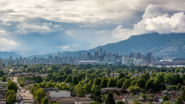 Vancouver skyline time lapse LS Time lapse of Vancouver skyline in the afternoon. Mount Cypress is in the background. vancouver canada stock videos & royalty-free footage
