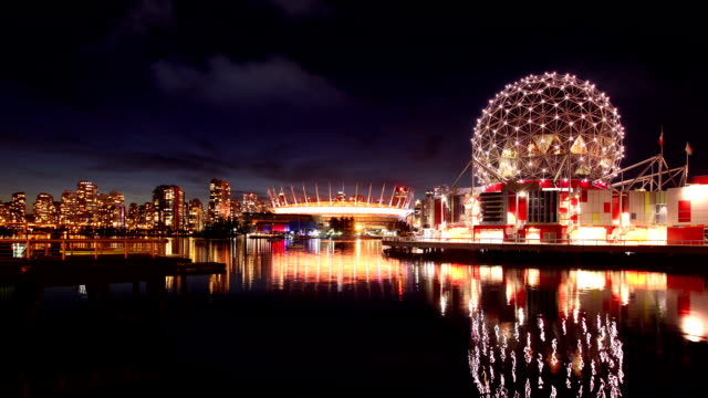 Vancouver Skyline with Science world and Stadium, Canada Timelapse of the Vancouver Skyline with Science world and the BP Place Stadium at night, Vancouver, Canada  vancouver canada stock videos & royalty-free footage