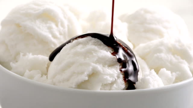 vanilla ice cream with chocolate syrup pour slow motion - gelato video stock e b–roll