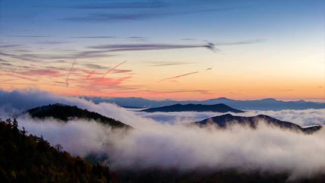 Vanilla Sky Morning with Fast Moving Mist in Appalachain Mountains Early Morning with a Vanilla Sky and Fast Moving Mist over the Peaks of the Appalachian Mountains near Asheville in Western North Carolina. mountains in mist stock videos & royalty-free footage