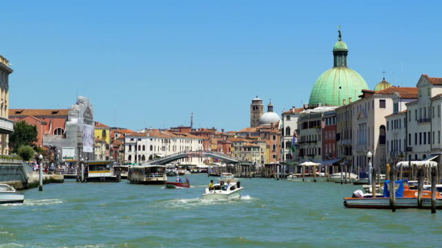 Vaporetto and motorboats moving down Grand Canal in Venice, transportation video