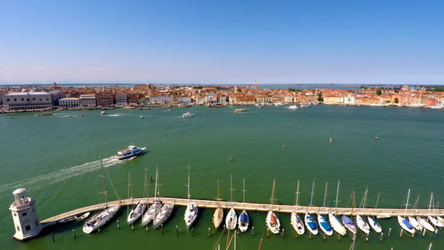 Vaporetto sailing near yacht club in Venice, cruise tour on Grand Canal, tourism video