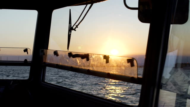 Vaporetto taxi swaying on waves, beautiful sunset on horizon, view from cabin video