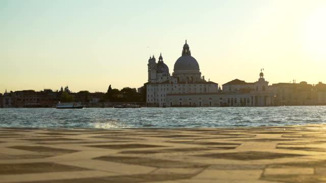 Vaporettos floating on Grand canal along Santa Maria della Salute church, Venice video