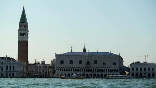 Vaporettos sailing near famous Doge's Palace in Venice, water tour, tourism video