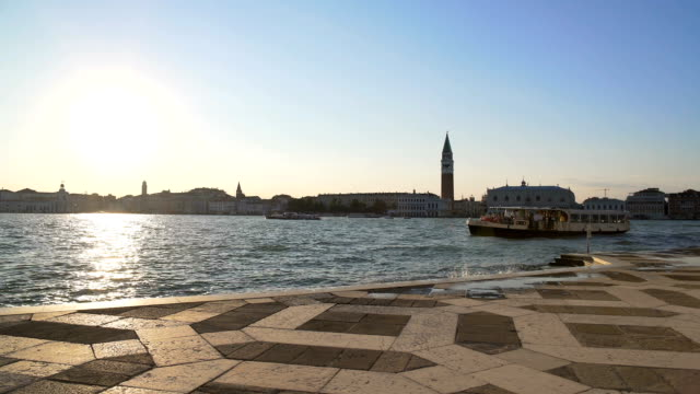 Vaporettos sailing parked near pier in Venice, water transport in Italy, travel video