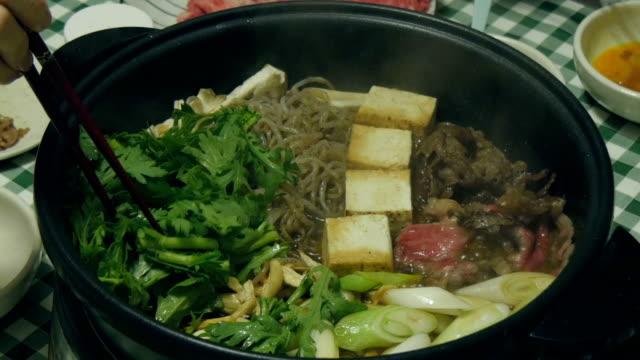 Variation of preparing home style Sukiyaki Dinner. video