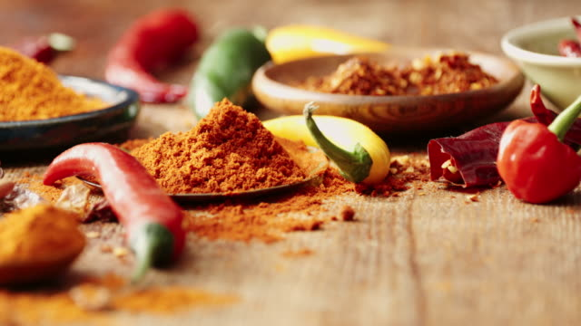 Variation of Spices and Herbs Variation of Spices and Herbs like chili peppers, parsley, rosemary, peppercorns, cayenne pepper, turmeric, cumin, garlic and ginger spice stock videos & royalty-free footage