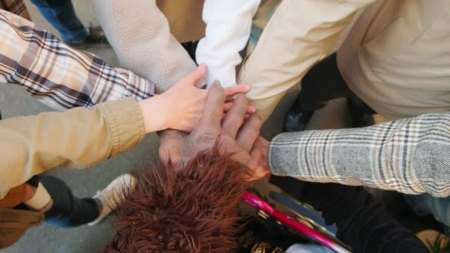 varied ability and ethnicity group with bigfoot celebrating - bigfoot video stock e b–roll