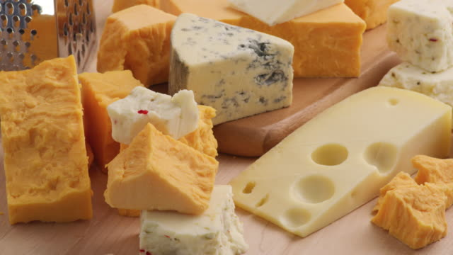 Video Variety of Cheeses; Cheddar, Blue Cheese, Swiss, Pepper Jack.