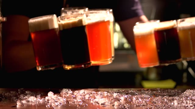 Variety of colourful beers place on table. video
