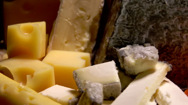 Variety of French cheeses Variety of French cheeses Parmesan Camembert Etorki Roquefort Mimolette cheese stock videos & royalty-free footage