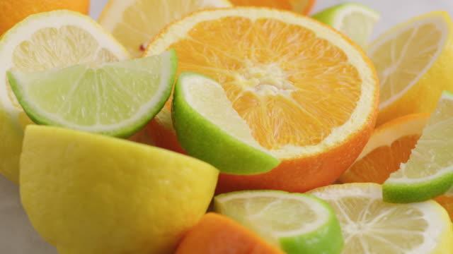 Variety of fresh sliced citrus fruits.  Orange, Lemon, Lime.