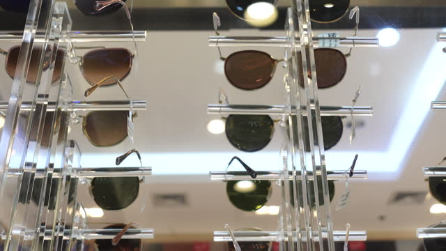 Variety of sunglasses display in optical shop summer and fashion accessory eye protection