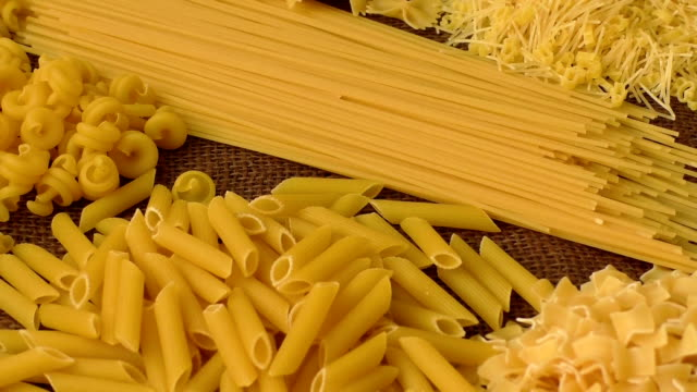 Variety of types and shapes of Italian pasta Variety of types and shapes of Italian pasta uncooked pasta stock videos & royalty-free footage