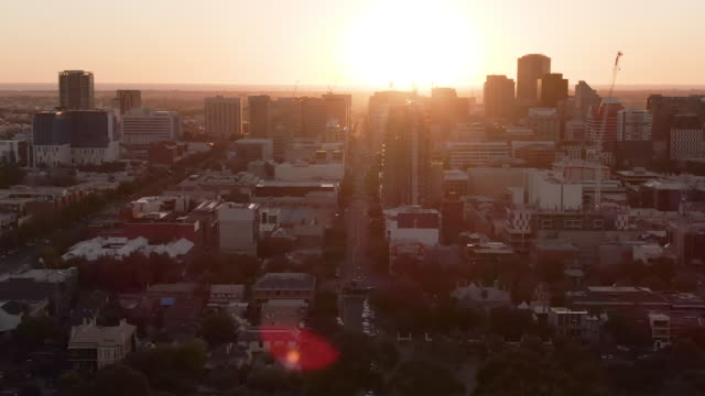 Various aerial shots of Adelaide city near sunset. Lens flare and aeroplane visible in some. South Australia.