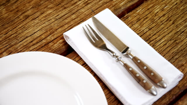 Various cutlery on wooden table 4k video
