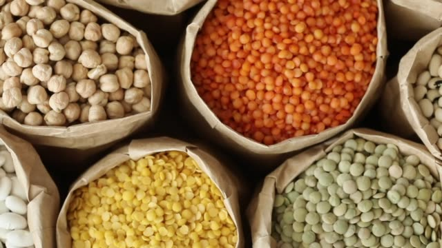 Various dried legumes high angle view Various dried legumes high angle view raw footage stock videos & royalty-free footage