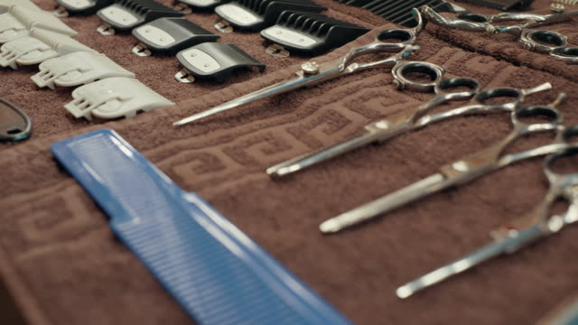 Various hairdressing tools on towel