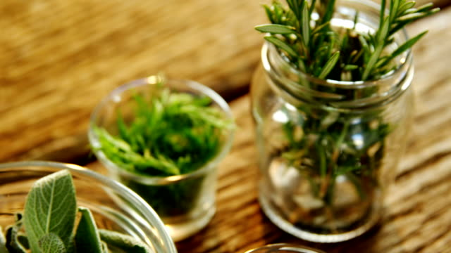 Various herbs in a jar on wooden table 4k Close-up of various herbs in a jar on wooden table 4k spice stock videos & royalty-free footage