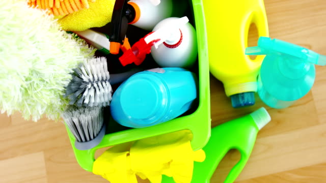various housekeeping supplies in a bucket - addetto alle pulizie video stock e b–roll