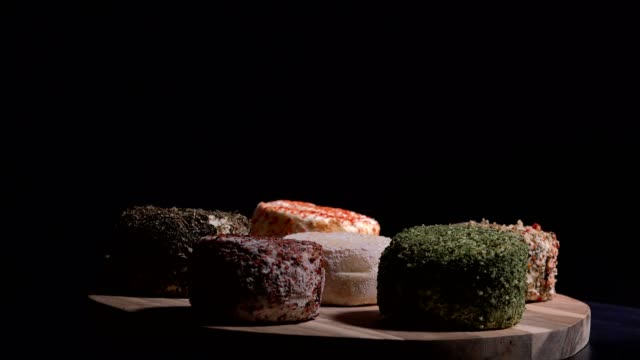 Various of local speciality goat cheese on turntable video