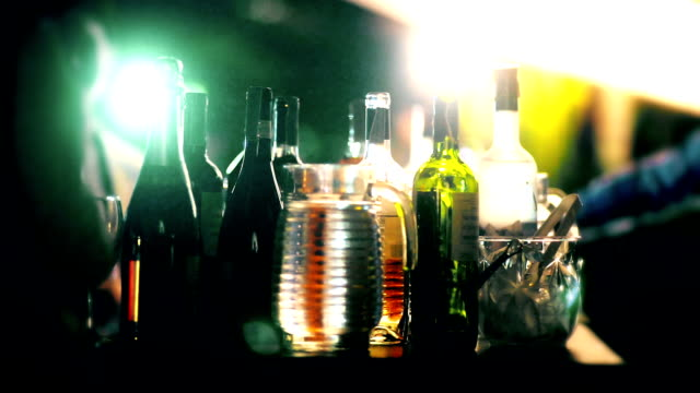 Various of the alcohol bottle served at the bar counter in party at night.