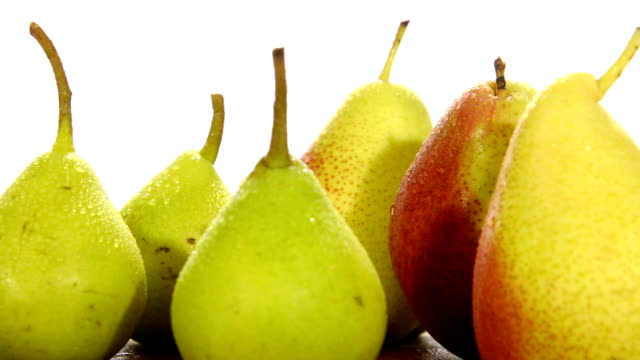 various pears various pears on white background pear stock videos & royalty-free footage