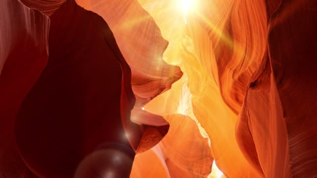 Various red and orange rocks in antelope canyon. Midday sun hits the antelope canyon whimsically illuminating canyon walls.  Red walls of Antelope Canyon in Arizona, USA, United States