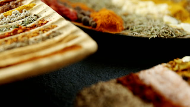 Various spices arranged in tray 4k video