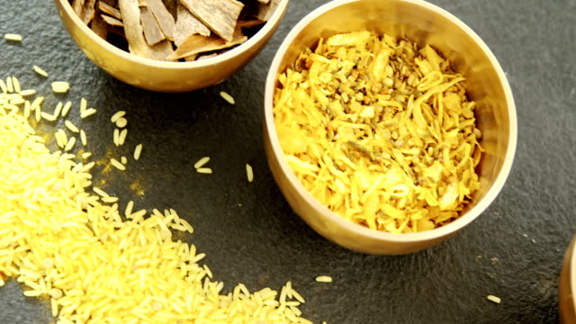 Various spices in bowl with yellow rice 4k video