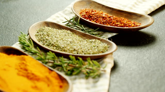 Various spices with herbs in a tray 4k video