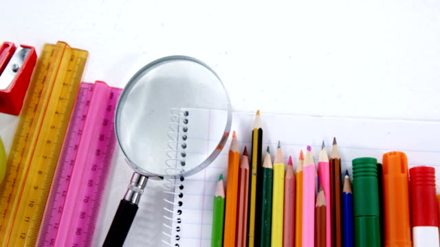 Various stationery on white background video