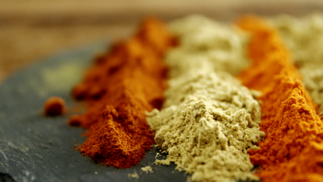 Various type of spice powder on tray 4k video