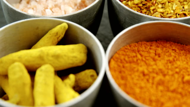 Various type spices in bowl 4k video