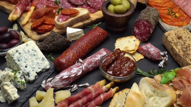 various types of italian food - cheese, sausage and tomatoes