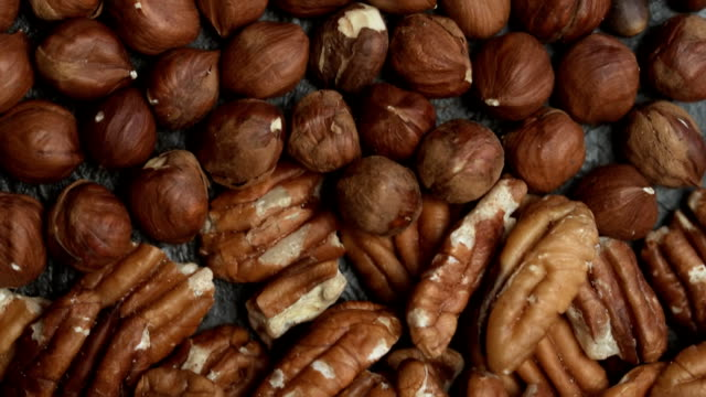 Variuos nuts close-up Various nuts close-up flat dolly shot pine nut stock videos & royalty-free footage