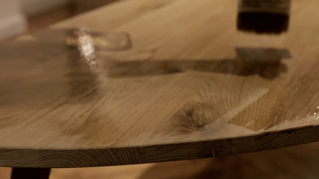 Varnishing a wooden table