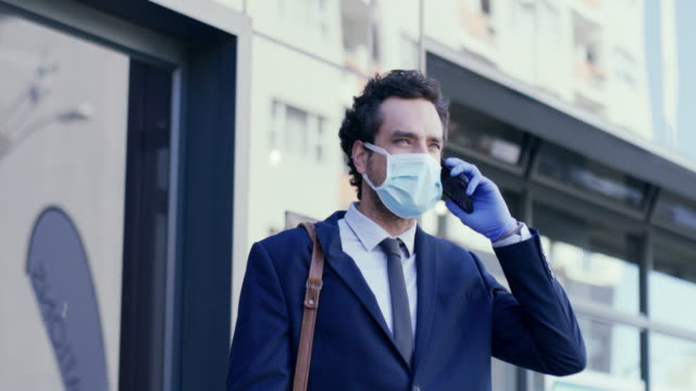 i've just left the office... - businessman covid mask video stock e b–roll