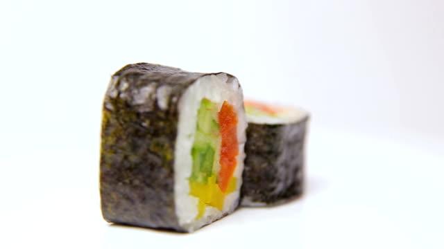 vegan vegetarian sushi rolls ratation on white, isolated video