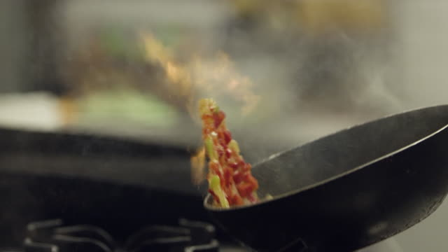 vegatables cooking on pan with wok fire - italian food stock videos & royalty-free footage