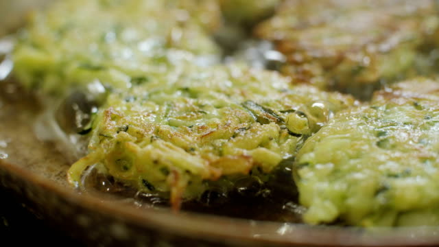 vegetable fritters - zucchini video stock e b–roll