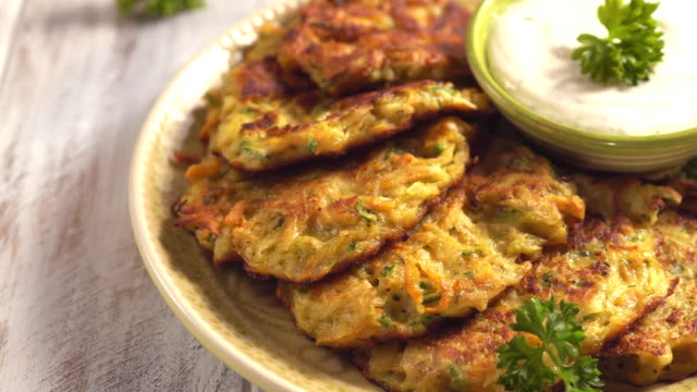 Vegetable fritters with potato, carrot and zucchini with Ranch sauce video