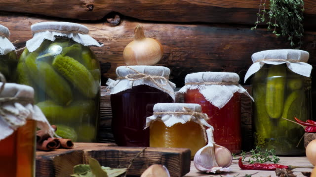 Vegetable preserves on kitchen table Vegetable preserves and pickles with herbs and seasonings on kitchen table pickle stock videos & royalty-free footage