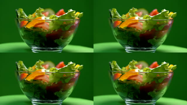 Vegetable salad in glass bowl rotating, vegetarian food, tasty appetizer, diet Vegetable salad in glass bowl rotating, vegetarian food, tasty appetizer, diet salad bowl stock videos & royalty-free footage