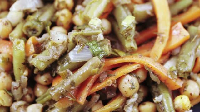 Vegetable salad on a plate On a blue plate vegetable salad salad bowl stock videos & royalty-free footage