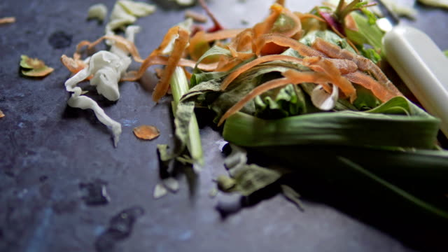 vegetable scraps food waste on kitchen board, cabage, carot, lettice, cucumber vegetable scraps food waste on kitchen board, cabage, carot, lettice, cucumber leftovers stock videos & royalty-free footage