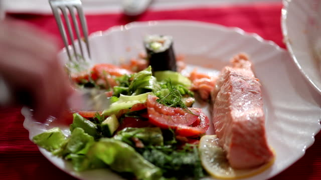 Vegetables and fish steak on the plate video